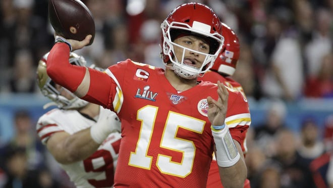 FILE - In this Feb. 2, 2020, file photo, Kansas City Chiefs quarterback Patrick Mahomes (15) passes against the 49ers during the first half of the Super Bowl 54 in Miami Gardens, Fla.
