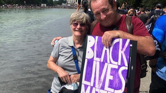 """Jean MacNaughton and her twin brother, John MacNaughton, of Adrian are pictured during the """"Commitment March: Get Your Knee Off My Neck"""" on Friday in Washington, D.C."""