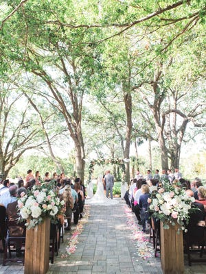 """TOP: Couples can say """"I do"""" under a canopy of trees. RIGHT: A private room for the bride and her bridesmaids to get ready."""