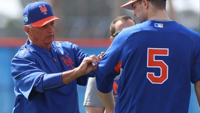 Terry Collins interacts with David Wright earlier this week.