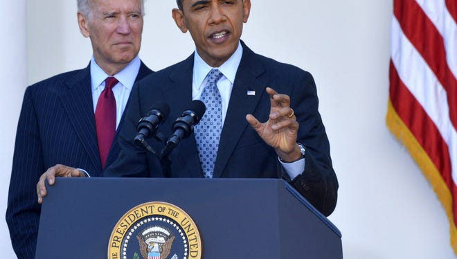 President Barack Obama, accompanied by Vice President Joe Biden, makes a statement on the Affordable Care Act.