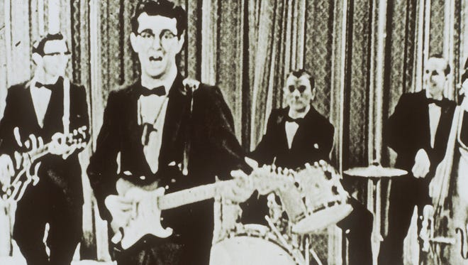 Buddy Holly appears on The Ed Sullivan Show, backed by the Crickets. Bassist Joe B. Mauldin, far right, died Saturday, Feb. 7, 2015, in Nashville.