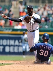 Tigers second baseman Niko Goodrum throws to first