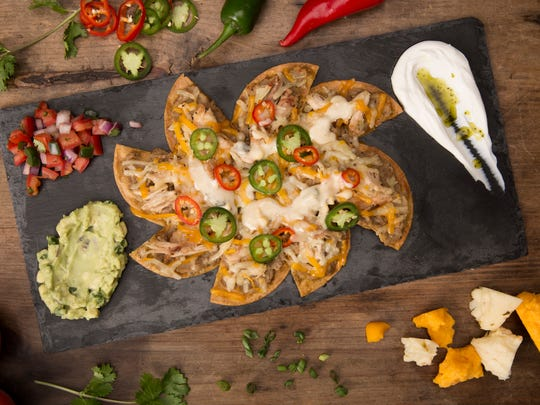 TopGolf's signature oversized nachos are topped with