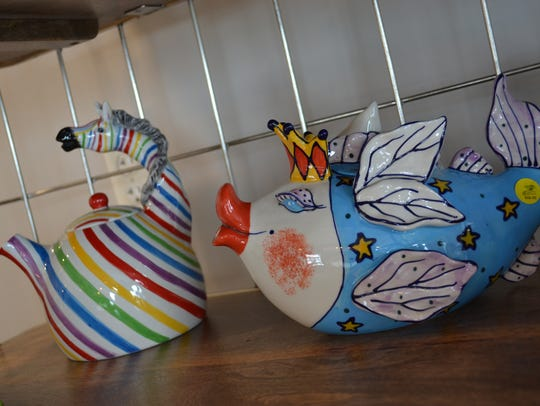 Whimsical teapots are available for sale at R Coffee