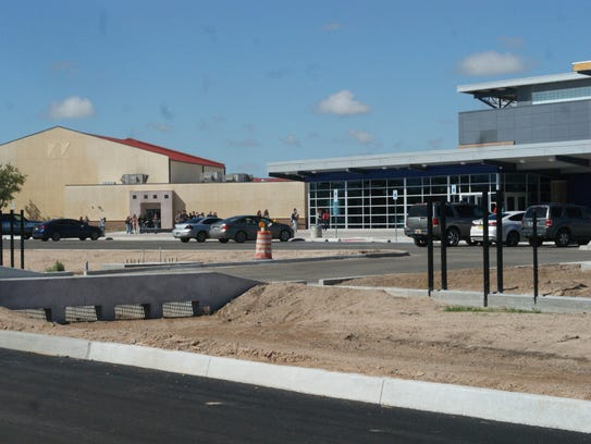 In this file photo, students cross from Deming High School's Hofacket building, left, to the new Iron Street campus.