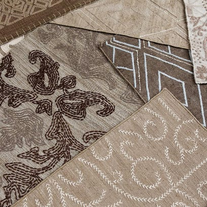 One of the collections of SHIIR rugs designed by Shea Soucie and Martin Horner features embellishment and embroidery hand-stitched on top of flat-woven backgrounds. One silk flat-weave features a classic Moorish tile motif with silk embroidery.
