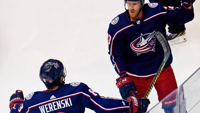 Center Riley Nash, right, and defenseman Zach Werenski react after Nash scores a goal for the Blue Jackets early in the second period of Saturday night's game.