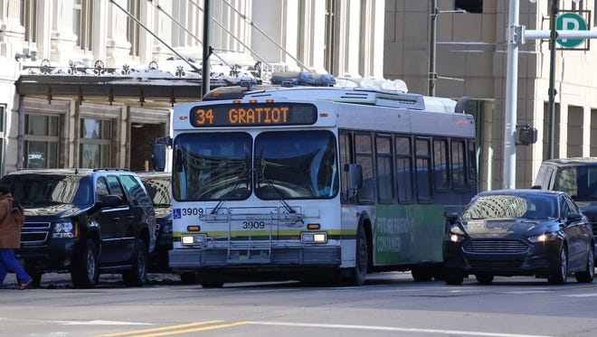 A bus travels Westbound on Michigan Ave., in downtown Detroit  on Thursday, Feb. 5,  2015.