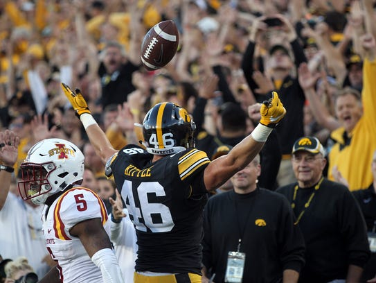 Iowa tight end George Kittle celebrates his 9-yard