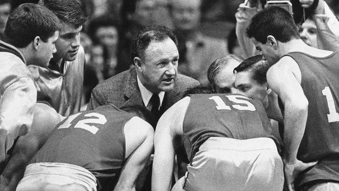 "From Dec. 6, 1985, actor Gene Hackman gives fictional Hickory High basketball players instructions during filming of the final game of the movie ""Hoosiers"" at Hinkle Fieldhouse on the Butler University campus in Indianapolis. ""Hoosiers"" shot all the way to No. 1 in The Associated Press Top 25 of best sports movies, a one-of-a-kind poll from the news organization known for its rankings of college teams. Released in 1986 and starring Gene Hackman, ""Hoosiers"" led the tally in results released Friday, April 17, 2020, receiving 46 votes from a 70-person global panel of sports writers and editors who work for the AP."