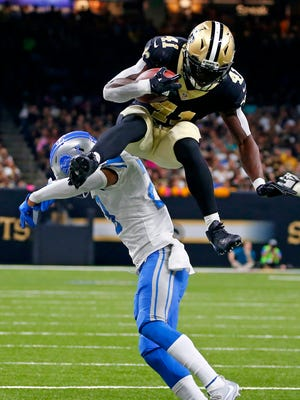 Saints running back Alvin Kamara leaps over Lions cornerback Darius Slay in the second half in New Orleans, Sunday, Oct. 15, 2017.