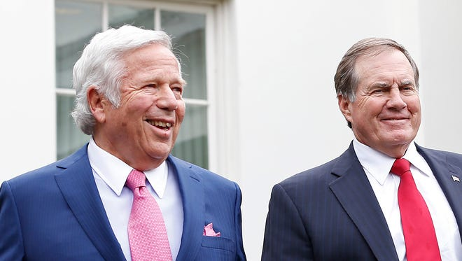 Owner Robert Kraft, left,  coach Bill Belichick and the Super Bowl champion Patriots were feted at the White House on Thursday.