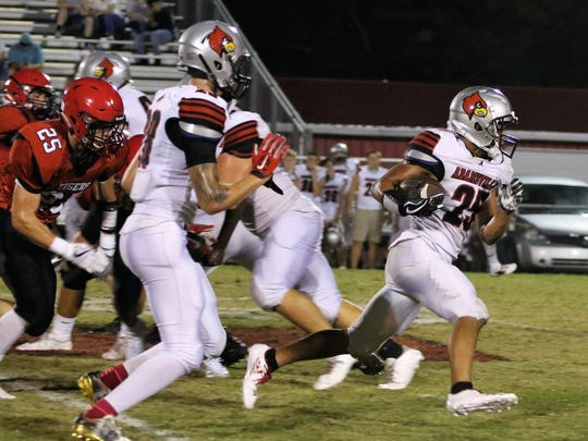 Adamsville's Blake Buntyn (25) breaks away against