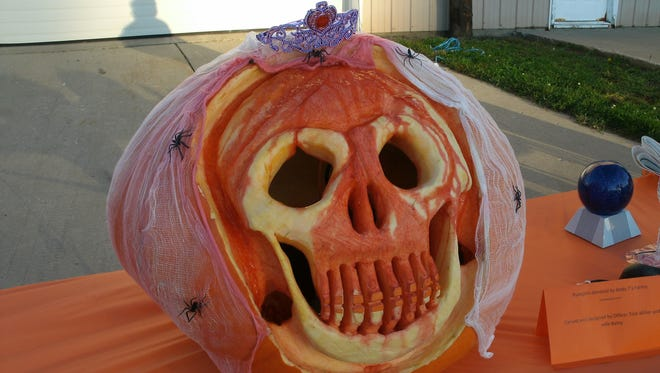 """Bath Township Officer Tom Miller's ghoulish, oozing jack-o-lantern was a Halloween hit at the """"Trunk Or Treat"""" event at Bath Elementary School in 2011."""