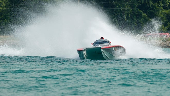 The Cleveland Construction boat roars through a turn Sunday, July 31, during the St. Clair River Classic Offshore Boat Races.