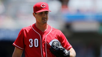 Cincinnati Reds starting pitcher Tyler Mahle (30) returns to the dugout after the top of the second inning of the MLB National League game between the Cincinnati Reds and the Colorado Rockies at Great American Ball Park in downtown Cincinnati on Thursday, June 7, 2018.