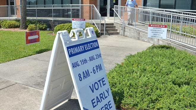 A sign directs people wanting to vote to the St. Johns County Supervisor of Elections office in 2014.