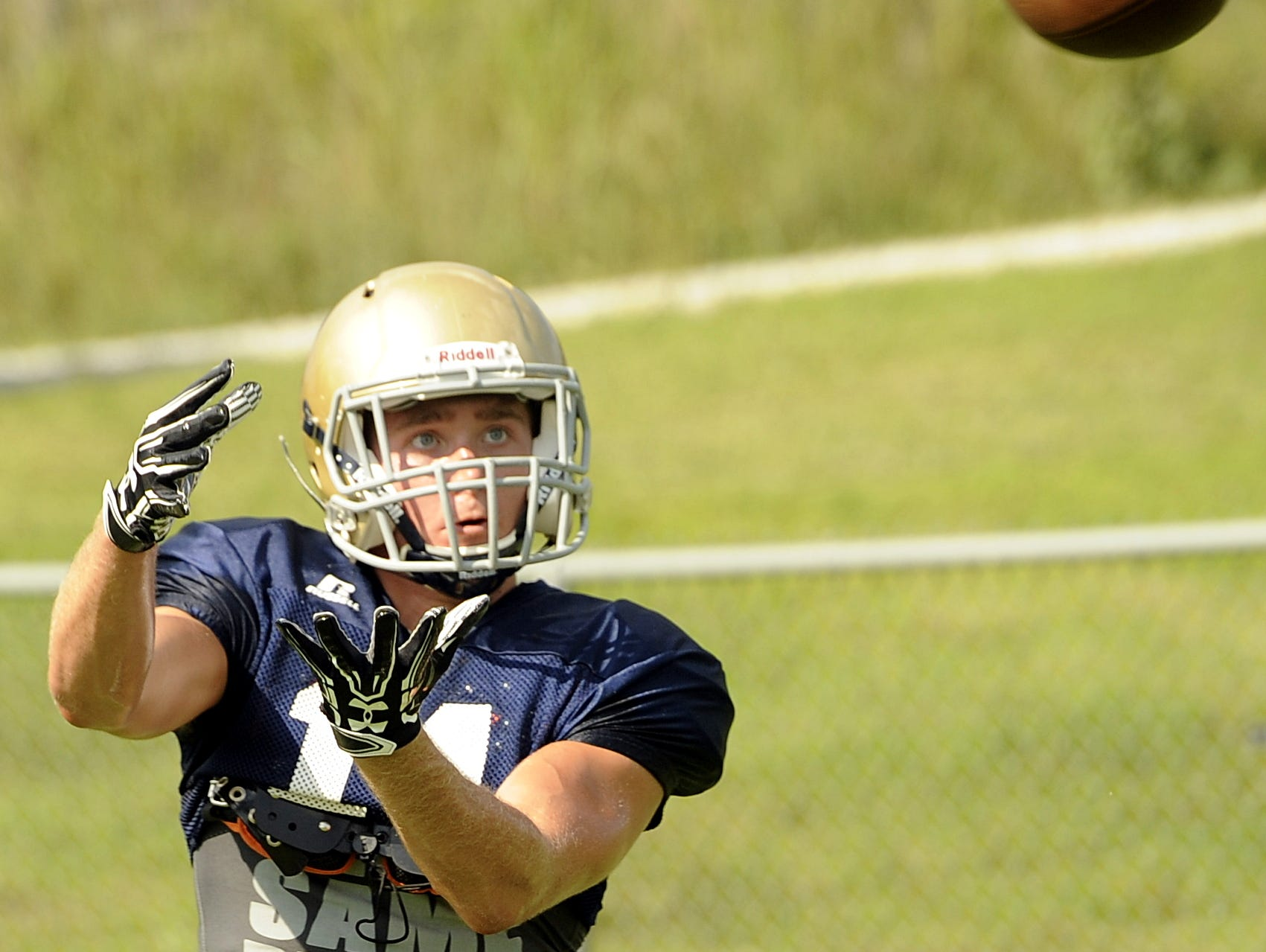 Independence wide receiver Owen Murphy catches a pass during Monday afternoon's practice.