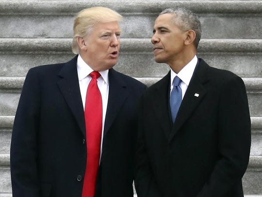 President Donald Trump talks with former President Barack Obama on Capitol Hill last January. Most analysts agree that Trump inherited a solid economy from Obama.