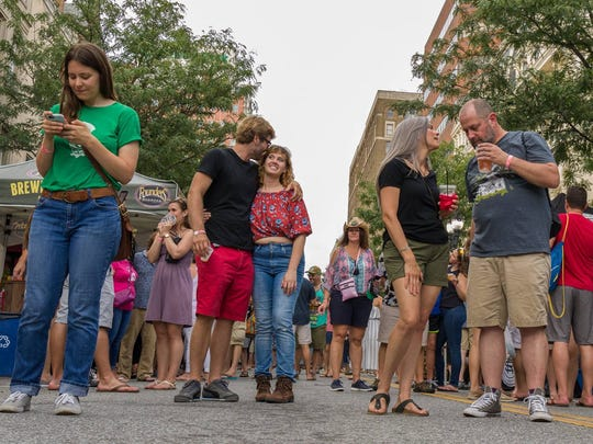 Beer fans fill North Market  Street at last year's debut Downtown Brewfest in Wilmington.
