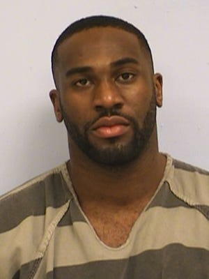 This undated booking photo provided by the Austin Police Department shows Alex Okafor. The Arizona Cardinals linebacker was jailed in Texas after leading police on a foot chase after a report of a disturbance in downtown Austin.