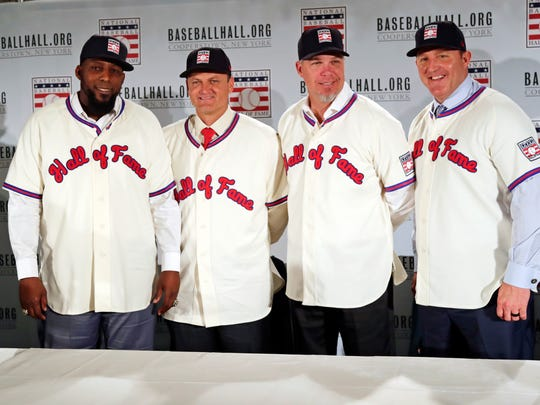 Baseball Hall of Fame inductees, from left, Vladimir Guerrero, Trevor Hoffman, Chipper Jones and Jim Thome, pose during news conference, Thursday, Jan. 25, 2018, in New York. Thome was honored in Rochester Monday at the Press-Radio Club's Day of Champions Dinner.