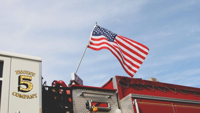 Mont Alto Fire Company's fire engine flies Old Glory during the Memorial Day Parade in Waynesboro.