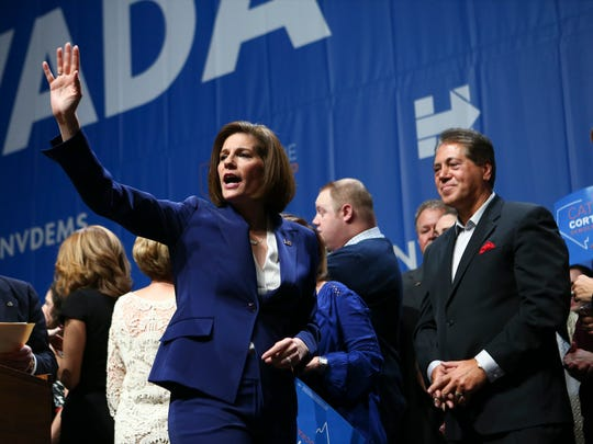 Sen.-elect Catherine Cortez Masto, D-Nev., waves to supporters after her victory at an election watch party in Las Vegas, Wednesday, Nov. 9, 2016.