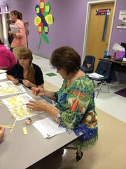 Carolyn Lang participates in a hands-on activity during a 4-H leadership conference in Shreveport.