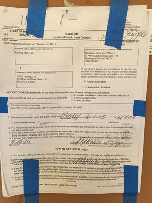 Lansing Mall posted an eviction notice on the back door of the stalled Toby Keith's I Love This Bar and Grill last spring.