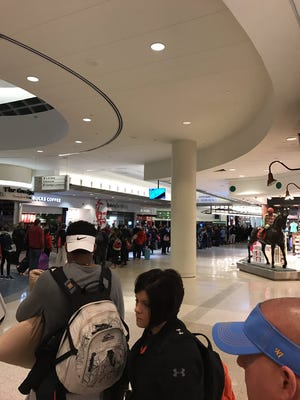 The security line at Louisville International Airport was long on Wednesday because of an early-morning power outage.