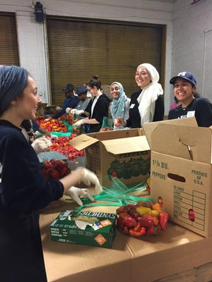 MMCC volunteers worked with Gleaners Community Food Bank of Southeastern Michigan in Detroit packing peppers June 3 as part of the annual Ramadan Fight Against Hunger.
