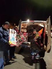 Toys for Tots coordinator Steve Topilnycky (left),