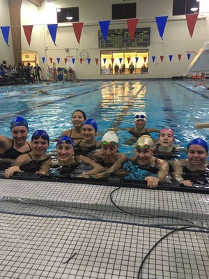 Members of the Verona swim team are in the pool in preparation of the program's first varsity swim meet.