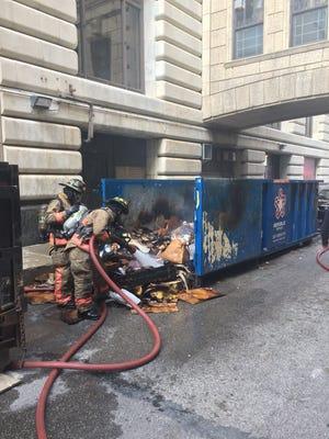 Cincinnati firefighters extinguish a dumpster fire Wednesday afternoon.