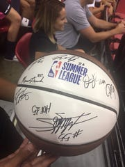 Mikey Torres, 16, of Las Vegas, shows off his signed basketball at NBA Summer League on Saturday.