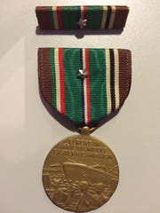 The European-African-Middle Eastern Campaign Medal was awarded by the United States for people who served in the European theater. It might belong to William H. Billman, who lived in Zanesville in 1946, as well.