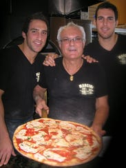 Mancini Pizza owners (from left to right) Frankie,