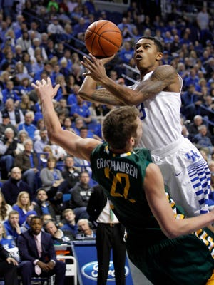 Kentucky Wildcats guard Tyler Ulis (3) shoots the ball against Wright State Raiders forward Parker Ernsthausen (22) in the first half at Rupp Arena.