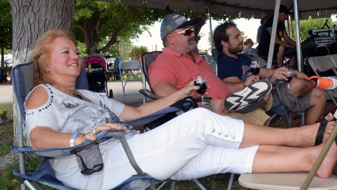 Liz Keith, Rob Keith and Carey Keith from El Paso enjoy some of the music Sunday, Sept. 4, 2016, at the New Mexico Harvest Wine Festival.