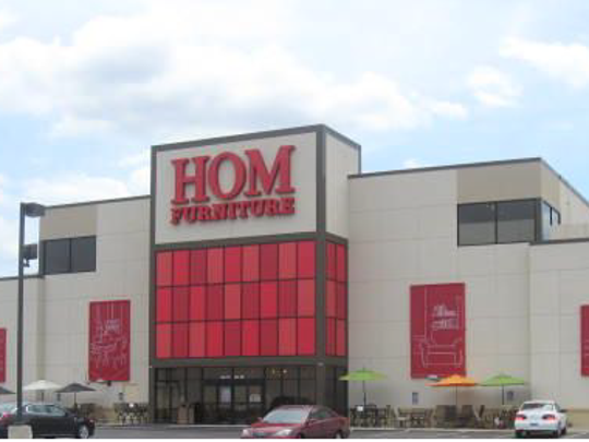 HOM Furniture included photos of other successfully remodeled retail spaces, such as this one in Rochester, which was formerly an abandoned Carson Pirie Scott.