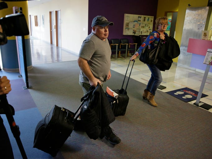 Brian Madeux, 44, arrives with his girlfriend, Marcie