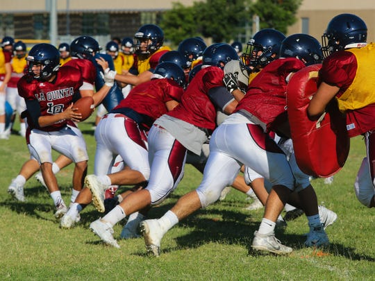 La Quinta High School football gets ready for the upcoming season at a summer practice, Monday, August 14, 2017.
