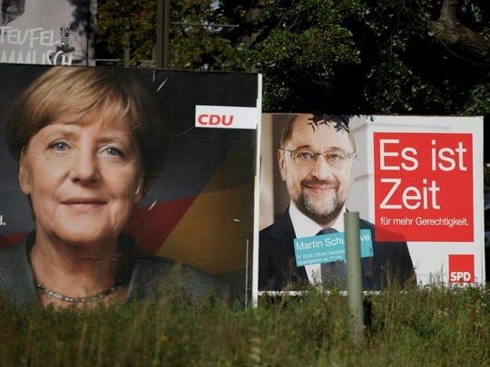 German Chancellor Angela Merkel, left, and her challenger,