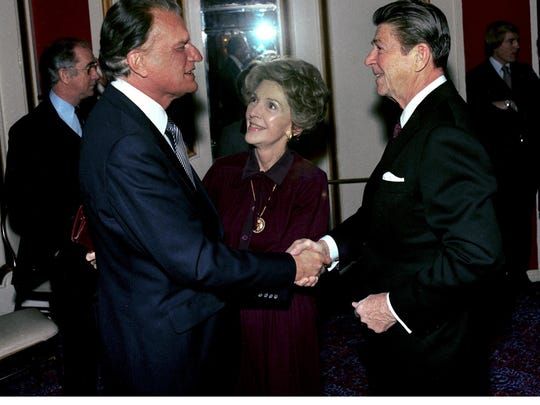The Rev. Billy Graham, shown here Feb. 5, 1981, at the National Prayer Breakfast in Washington, had known Ronald Reagan since 1952, the year Reagan married his second wife, Nancy Reagan.