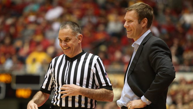 Iowa State head basketball coach Fred Hoiberg shares a laugh with a game official in the second half against Oklahoma State earlier this week. Hoiberg discussed his dance moves from a viral Infiniti video before Saturday's game against West Virginia.