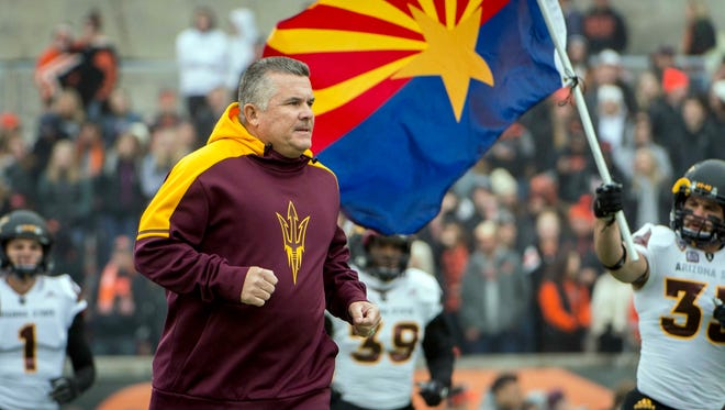 Nov 18, 2017: Arizona State Sun Devils head coach Todd Graham runs with his team before a game against the Oregon State Beavers at Reser Stadium. The Sun Devils won 40-24.