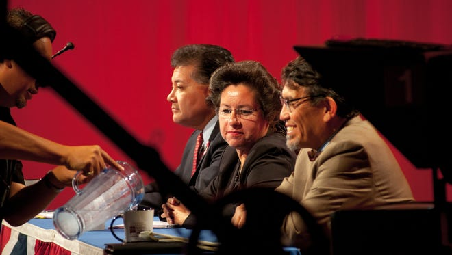 Las Cruces mayoral candidates Ken Miyagishima, left, Gina Montoya Ortega and Miguel Silva before the start of Wednesday's mayoral debate at television station KRWG.