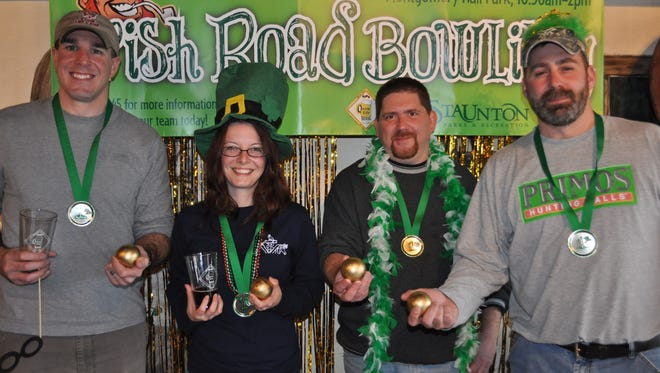 Edan Valkner, Misty Valkner, Cory Baldwin and Don Mongold of Staunton Brew Crew, overall winners of last year's Irish Road Bowling.